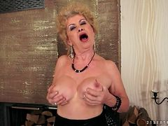 Granny in a slutty dress strips and masturbates
