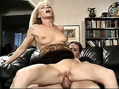 Naughty blonde mom with big boobs Nicole has a young guy satisfying her desires