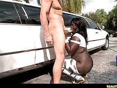She is giving Jmac a blowjob outside by the limo.