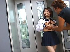 Haiji Cute Asian girl smiles and has titties tweaked for a shot