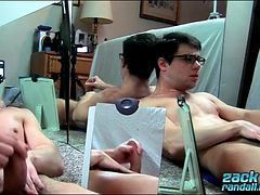 Young guy in glasses strokes and licks his cum