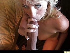 Kinley is giving VooDoo a blowjob on the floor then they switch positions and go on the bed for sex in the missionary position.
